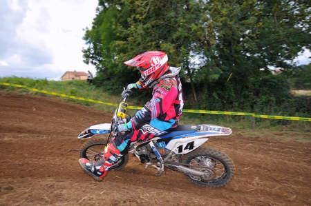 number 14: VALDESOTO, SPAIN - AUGUST 8: Asturias Motocross Championship in August 8, 2015 in Valdesoto, Spain. Unai Gerrika rider with the number 14