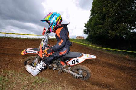 hugo: VALDESOTO, SPAIN - AUGUST 8: Asturias Motocross Championship in August 8, 2015 in Valdesoto, Spain. Hugo Fernandez rider with the number 4