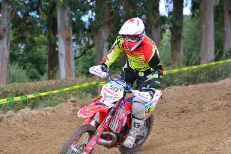 number 50: VALDESOTO, SPAIN - AUGUST 8: Asturias Motocross Championship in August 8, 2015 in Valdesoto, Spain. Adrian Noriega rider with the number 50. Editorial