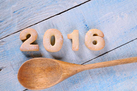 sweet food: 2016 homemade cookies on wooden table in the kitchen