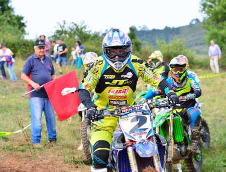 alvaro: SARIEGO, SPAIN - AUGUST 17: Legendary Sariego motocross test in August 17, 2015 in Sariego, Spain. Alvaro Lozano rider with the number 2