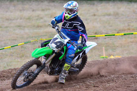 number 14: SARIEGO, SPAIN - AUGUST 17: Legendary Sariego motocross test in August 17, 2015 in Sariego, Spain. David Miranda rider with the number 14 Editorial