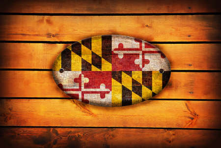 maryland flag: A Maryland flag on brown wooden planks. Stock Photo