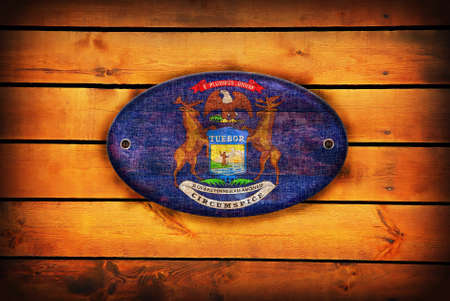 michigan flag: A Michigan flag on brown wooden planks. Stock Photo