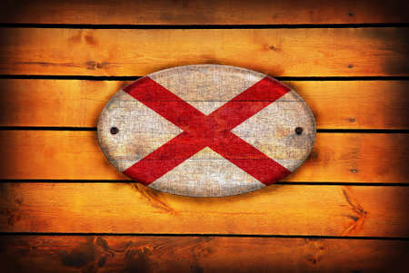 alabama flag: A Alabama flag on brown wooden planks. Stock Photo
