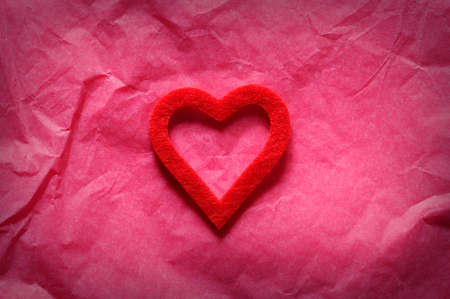 event: Red heart on pink paper.From above Stock Photo