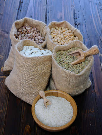 bean bag: Different kind of peas in textile bags and white rice in bowl
