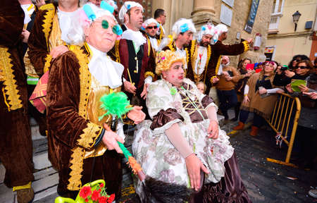 chorus: CADIZ, SPAIN - FEBRUARY 8: Typical carnival chorus (chirigota) sing during the carnival in the streets in January 8, 2016 in Cadiz, Spain. Editorial