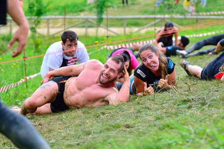 barbed wires: OVIEDO, SPAIN - JUNE 5: Storm Race, extreme obstacle race in June 5, 2016 in Oviedo, Spain. People jumping, crawling,passing under a barbed wires or climbing obstacles during extreme obstacle race.