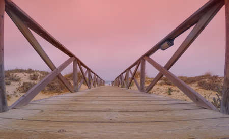endless: Endless way leading to pink evening sky Stock Photo