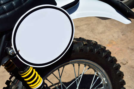 space weather tire: Close-up of motorcycle with white round board with blank space
