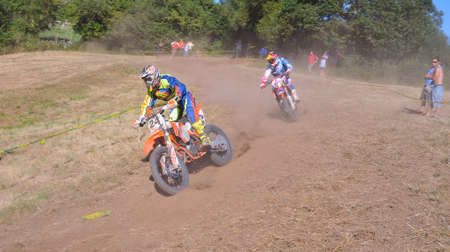 julio: SARIEGO, SPAIN - AUGUST 22: Legendary Sariego motocross test in August 22, 2016 in Sariego, Spain. Julio Pando rider with the number 24.