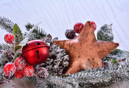 snowed: Close-up of Christmas star in snowed fir tree branch with x-mas red ball Stock Photo