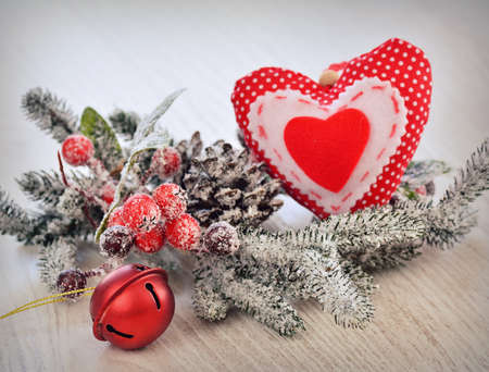 Stil: Stil life of fir-tree branch,christmas ball and heart handmade decoration in close-up Stock Photo