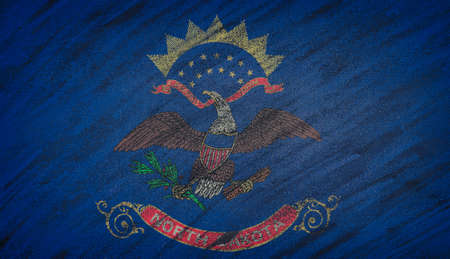 north dakota: Close-up of national North Dakota state flag painted with colored chalk on a blackboard.