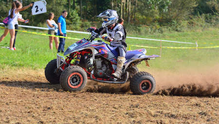 CARDO, SPAIN - SEPTEMBER 4: Unidentified racer rides a quad motorbike in the Promotion Quad Trophy Astur on September 4, 2016 in Cardo, Spain. Editorial