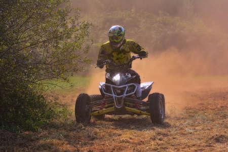 quad: Rider on a quad motorbike at dawn.