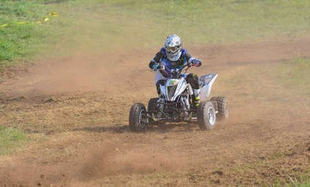 quad: CARDO, SPAIN - SEPTEMBER 4: Unidentified racer rides a quad motorbike in the Promotion Quad Trophy Astur on September 4, 2016 in Cardo, Spain. Editorial