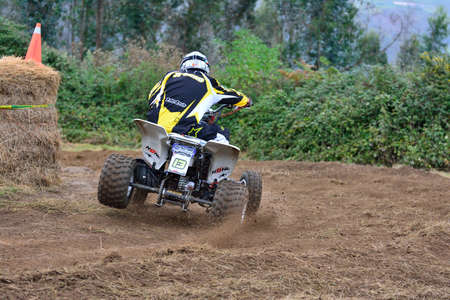 quad: ESCAMPLERO, SPAIN - SEPTEMBER 25: Unidentified racer rides a quad motorbike in the Promotion Quad Trophy Astur on September 25, 2016 in Escamplero, Spain. Editorial