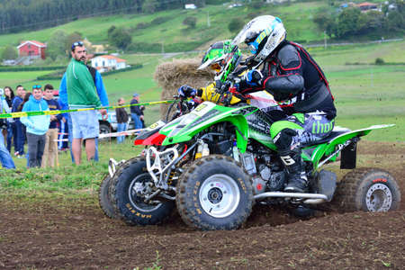 GOZON, SPAIN - MAY 13: Unidentified racers rides a quad motorbike in the Promotion Quad Trophy Astur on May 13, 2017 in Gozon, Spain.