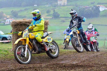 GOZON, SPAIN - MAY 13: Unidentified racers rides a classic motorcycle in the Classic Trophy Mx Astur on May 13, 2017 in Gozon, Spain. Editorial