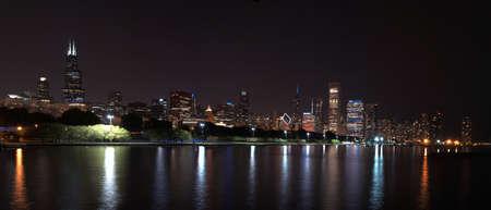 Chicago night skyline across Lake Michigan.