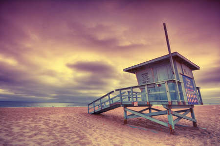 Lifeguard tower with of a sunset at Hermosa Beach, California