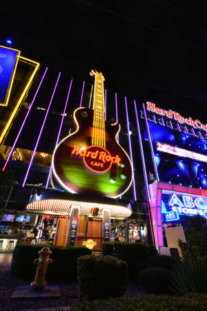 LAS VEGAS, NEVADA - JULY 25, 2017: Night view of The Hard Rock Cafe on the Strip. The Hard Rock Sign is embedded in a Gibson Les Paul Guitar III in Las Vegas on July 25, 2017. Editorial