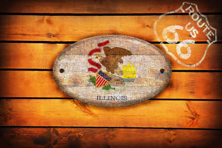 Brown wooden planks with the Illinois flag and shield of Route 66. Stock Photo