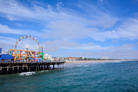 Santa Monica, California - July 27, 2017: Santa Monica Pier  in Los Angeles. The pier is a more than hundred-year-old historic landmark that contains Pacific Park, an amusement park.