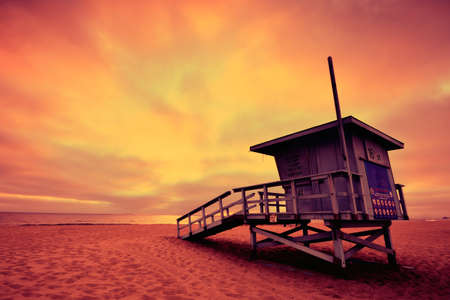 Lifeguard tower with the rosy afterglow of a sunset at Hermosa Beach, California