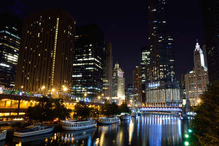 Chicago, Usa - July 15, 2017: Downtown Chicago at night. View of Illuminated buildings in the central part of the city. Trump Tower and The Wrigley Building reflected in Chicago river.