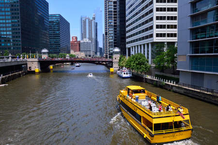 Chicago, Usa - July 15, 2017: Chicago Water Taxi on the Chicago River in downtown Chicago on July 15, 2017. The Chicago River serves as the main link between the Great Lakes and the Mississippi Valley waterways. Editorial