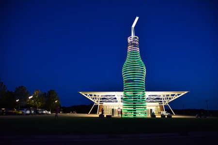Arcadia, Oklahoma - July 19, 2017: Drive down historic route 66 through Arcadia, Oklahoma, and you can not miss the 66-foot-tall soda bottle in front of POPS. The biggest bottle of soda in the world