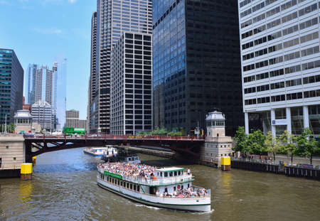 Chicago, Usa - July 15, 2017: Water Taxi on the Chicago River in downtown on July 15, 2017. The Chicago River serves as the main link between the Great Lakes and the Mississippi Valley waterways.