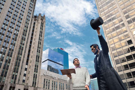 Chicago, IL - July 15, 2017: Statue of Americas 16th president was installed at Pioneer Court on Michigan Avenue. It depicts Lincoln handing a copy of the Gettysburg Address to a modern day man. The large bronze scultpure called Return Visit was created  Editorial