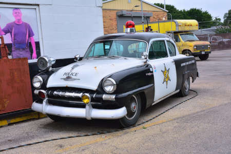 Joliet, Illinois, USA - July 16, 2017: Police car on Dicks Towing roadside attraction in the US Route 66 in Joliet, Illinois, USA. Sajtókép