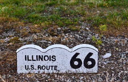 Historic Route 66 road sign on a brick in Illinois.