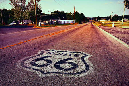 US Route 66 highway, with sign on asphalt on Missouri.