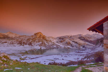 Panoramic view of Lake Ercina with snow in Asturias, Spain.
