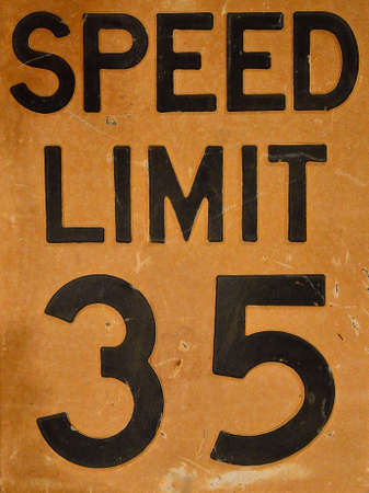 Close up of old speed limit 35 sign.