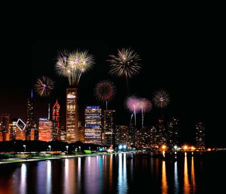 Chicago night skyline across Lake Michigan with fireworks.