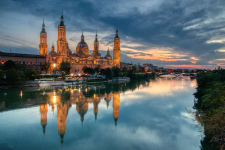 Basilica of our Lady of the Pillar and Ebro river in the evening, Zaragoza, Aragon, Spain.