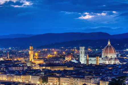 Duomo Santa Maria Del Fiore and tower of Palazzo Vecchio at sunset in Florence, Tuscany, Italy Banco de Imagens
