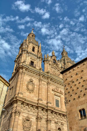 Famous Casa de las Conchas with La Clerecia Church in Salamanca, Castilla y Leon, Spain.