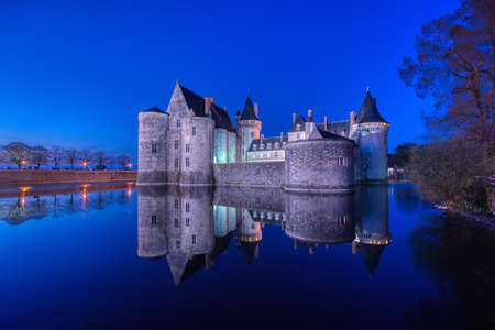 Sully Sur Loire, France - April 13, 2019: Famous medieval castle Sully sur Loire at night, Loire valley, France. The chateau of Sully sur Loire dates from the end of the 14th century and is a prime example of medieval fortress. Blue hour.