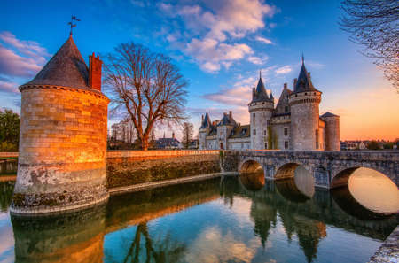 Sully Sur Loire, France - April 13, 2019: Famous medieval castle Sully sur Loire at sunset, Loire valley, France. The chateau of Sully sur Loire dates from the end of the 14th century and is a prime example of medieval fortress. Blue hour. Editöryel