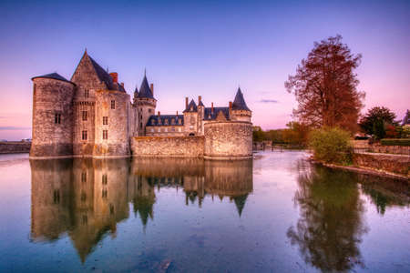 Sully Sur Loire, France - April 13, 2019: Famous medieval castle Sully sur Loire at sunrise, Loire valley, France. The chateau of Sully sur Loire dates from the end of the 14th century and is a prime example of medieval fortress.