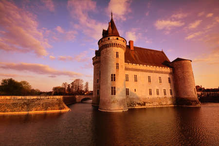 Sully Sur Loire, France - April 13, 2019: Famous medieval castle Sully sur Loire at sunrise, Loire valley, France. The chateau of Sully sur Loire dates from the end of the 14th century.