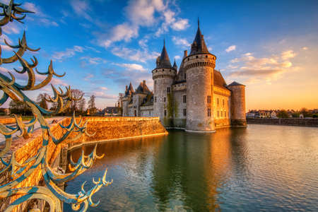 Sully Sur Loire, France - April 13, 2019: Famous medieval castle Sully sur Loire at night, Loire valley, France. The chateau dates from the end of the 14th century and is a prime example of medieval fortress.